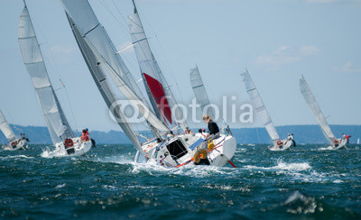 group of yacht sailing at regatta