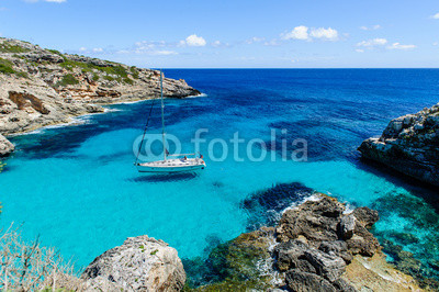 Sailing boat at anchor. Paradise wild bay. Cala Marmolis.