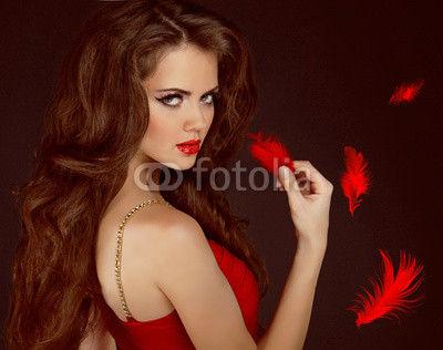 Woman with beauty long curly brown hair and red lips. Fashion wo